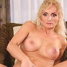 Horny cougar Kyra Blond toying her older pussy.