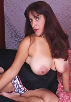 Veronica rubs big tits while jamming pussy with dildo.