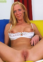 Blonde cougar Roxie stuffs big toy into her tight pussy.