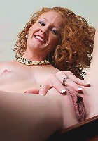 Small breasted curly redhead Ande exposes her older pussy.