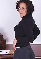 Older secretary Cielo butt naked on her office desk.