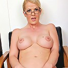 Busty secretary Anita Blue strips butt ass naked.
