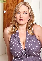 Thick MILF Vicky Vixen strips naked in the kitchen.