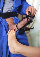 Lana has a hunky workmans cock out and is rubbing it with her feet