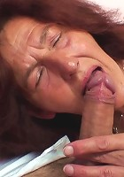 Sultry redheaded granny blows the man in bondage and gets on his cock for a fun ride