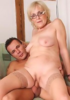 He pulls out and cums on her granny legs so she can lick it up and get a taste of the cum