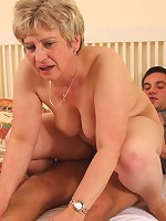After sucking him awake the mature slut gets on her hands and knees for his cock meat