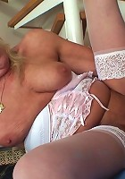 After fucking this steaming hot granny pussy he pulls out and shoots his load on her hair