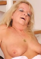 He fucks her old pussy with passion and then pulls out and ejects his load all over her snatch