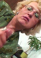 Super hot blonde grandma in her sexy glasses fucked by the young man with an active cock