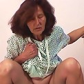 The redheaded old babe gives him a blowjob and she gets fucked lustily