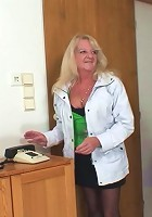 The mature blonde makes a call from his place and her big ass looks damn fine in the scene