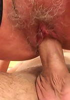 His stiff young meat penetrates her mature pussy balls deep while she rides him with lust