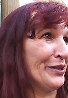 Redheaded mature craves young cock meat and he manages to convince her to fuck him