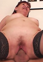 Mature pussy is opened up by his hard young cock and the granny slut can't get enough