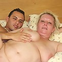 The chubby mature with big tits is in his bedroom with his cock inside her wet pussy
