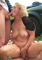 Outdoor fucking of the lusty grandma makes her happy and gets the guys to cum hard