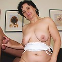 The threesome in her mature pussy features a young man and her old and chubby hubby