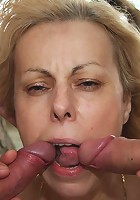 They fuck the granny in her mouth and her pretty pussy and she lets them go until they cum