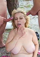 After they spend plenty of time fucking her on the beach the two young men cum on the chick