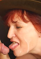 Two guys win at strip poker and the redheaded granny is getting cock deep in her pussy hole