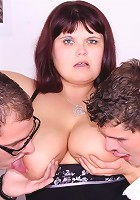 The two younger guys are giving the old slut the fucking of a lifetime and she wants more