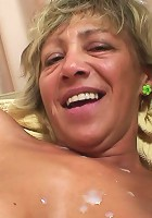 Two dicks fuck this granny slut and then they cum on her tits and make her smile
