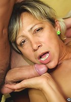 Mature slut makes them fuck her pussy and her mouth at gunpoint and they love it