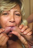 Granny has fun with a couple of rock hard cocks and they get to pump her holes