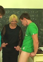 Gorgeous mature having a threesome in the classroom with two of her students