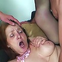 Her mature pussy and her mature mouth are filled with their eager dicks and she is very happy