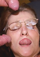The mature in glasses sucks dick and they end up cumming on her face and glasses