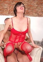 Clad in red busty milf Maia in steamy workout