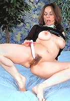 Flirtatious mature lady in lingerie shows all