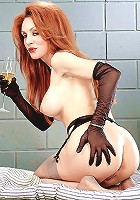 Busty mature posing in black stockings