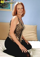 Mom wears her short skirt and poses in front of the camera