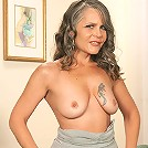Mature amateur beauty strips out of her sexy black lingerie