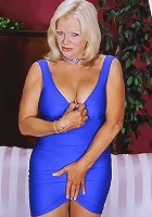 Busty mature works a big red toy in her pussy