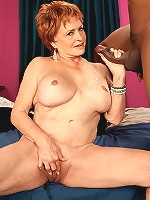 Busty blonde mature babe spreading her hairy pussy