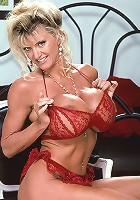 Sexy milf shows her big titties