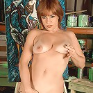 Sexy red head gets artistic