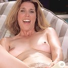 Dirty blonde MILF poolside with a dildo