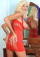 Blonde grannie reveals huge titties