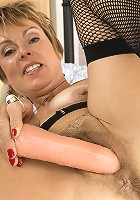 50 yr old stuffs her pussy