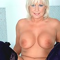 Busty milf Patsy exposing pink