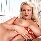 Big older woman pleasures her pussy