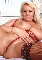Big older woman pleasures her pussy