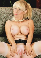 MILF with huge tits plays with herself