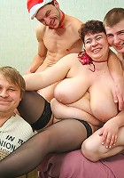 Busty old woman welcomes two cocks in all positions