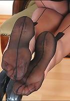 Mature feet in stockings